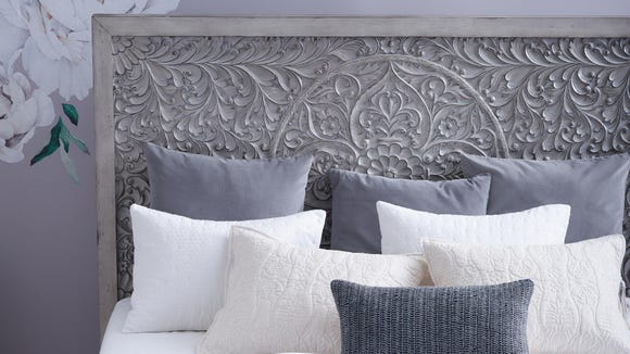 This elegant headboard is a total statement piece.