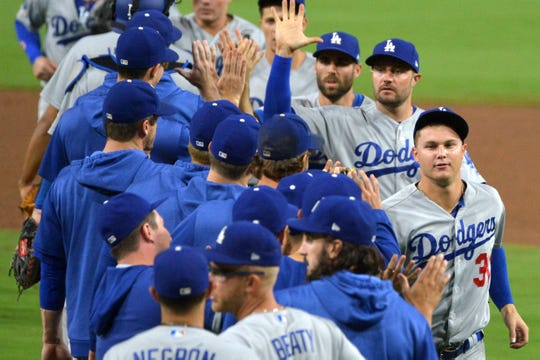 The Dodgers congratulate each other after a win.