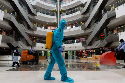 A worker sanitises the floor of a shopping mall reopened after the government eased a nationwide lockdown imposed as a preventive measure against the Covid-19 coronavirus, in Chennai on September 1, 2020.