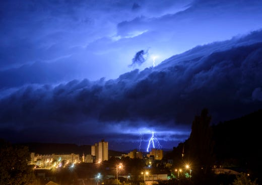 Lightning bolts illuminate the sky during a morning storm over Salgotarjan, Hungary, Tuesday, Sept. 1, 2020.