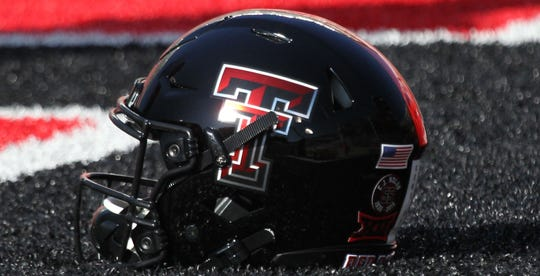 A Texas Tech helmet is seen in the end zone before a game against the Oklahoma State Cowboys at Jones AT&T Stadium on Oct. 5, 2019.