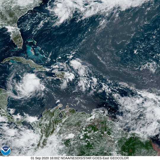 Tropical Storm Nana (left, south of Cuba) formed Tuesday in the Caribbean Sea. It's expected to hit Central America by Thursday.