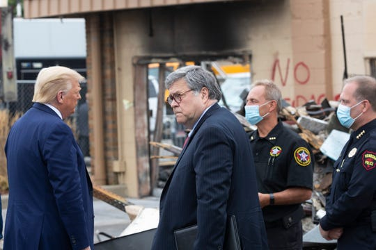 Attorney General William Barr stands by President Trump as he speaks to Kenosha County Sheriff David Beth and Kenosha Police Chief Daniel Miskinis Sept. 1, 2020 in Kenosha, Wis.