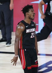 Jimmy Butler celebrates after making one of his 13 field goals. He finished with 40 points.