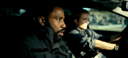 """John David Washington (left) and Robert Pattinson are secret agents dealing with time inversion and an end-of-the-world scenario in Christopher Nolan's sci-fi action movie """"Tenet."""""""