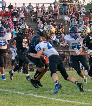Dickson senior Brian Jennings launches into a Hugo ball carrier last week. Jennings and the Comets travel to Comanche at 7:30 p.m. Friday, Sept. 4.