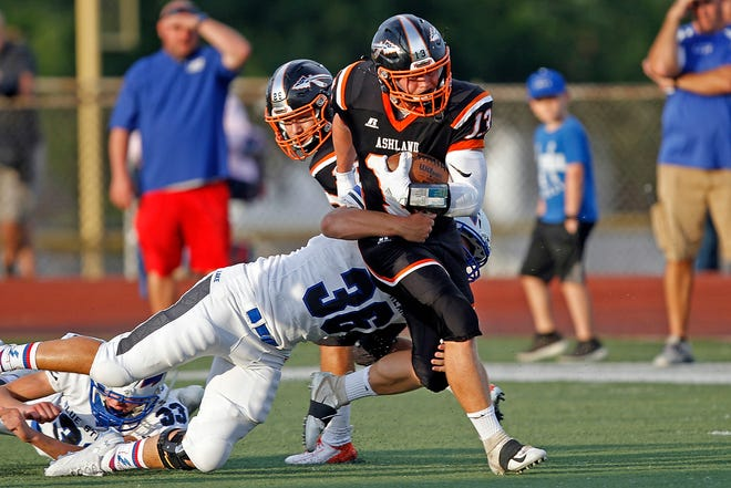 Ashland High's Ethan Hartley (13) is tackeld by Lake's Nick Maricocchi (36) during high school football action on Friday, Aug. 30, 2019 at Community Stadium.