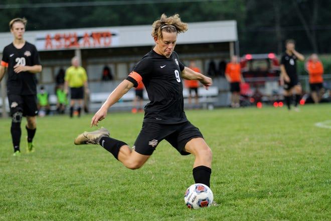 Ashland High's Dalton Hickey kicks the ball during the game against Lexington Tuesday night at Community Soccer Stadium.