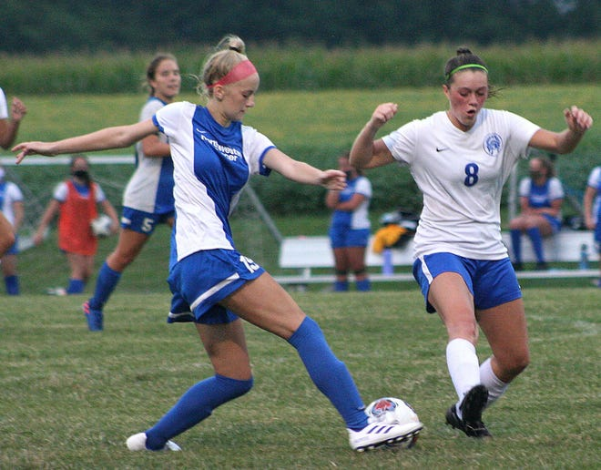Northwestern's Abbi Johns (19) make a move on Chippewa's Jenna Sheridan (8) during a high school girls soccer match on Tuesday night at Northwestern High School.  The Chipps defeated the Huskies, 3-1.