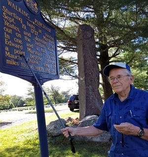 Carl LaVO at the roadside marker where the infamous Walking Purchase began; a stone monument behind him was established by the Bucks County Historical Society in 1886 to memorialize the site in front of the Quaker Meetinghouse on Route 413 in Wrightstown.