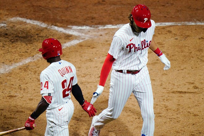 Phillies third baseman Alec Bohm, right, is congratulated by teammate Roman Quinn after Bohm hit a solo home run in the fifth inning of Tuesday night's game against the Nationals.