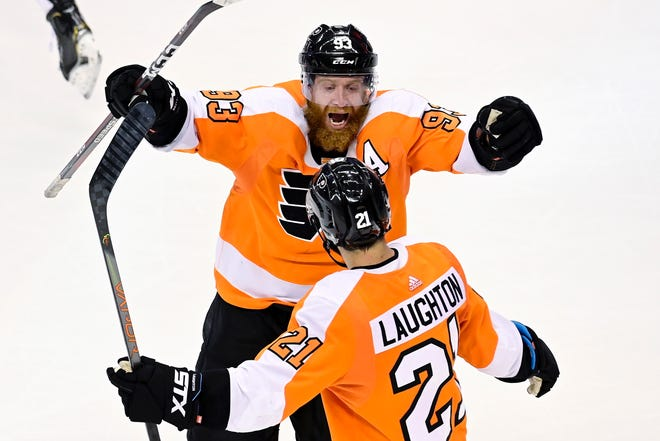 Flyers forward Jake Voracek celebrates a playoff win with teammate Scott Laughton, 21.