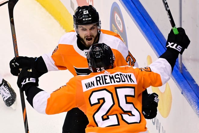 The Flyers' James van Riemsdyk, 25, celebrates his second-period goal with teammate Scott Laughton during Game 5 against the Islanders on Tuesday night.