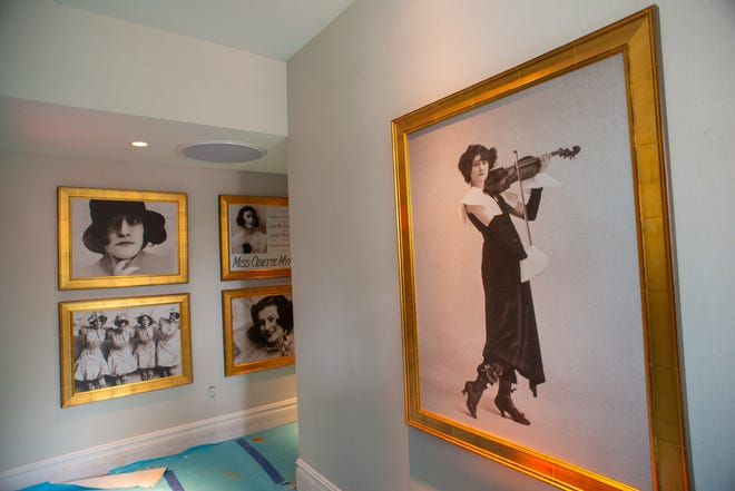 Large metal prints of Odette Myrtil Logan adorn the walls in a hallway at the new hotel.
