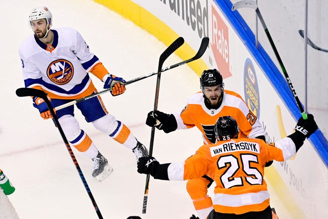 The Flyers James van Riemsdyk, 25, celebrates his goal with teammate Scott Laughton during Tuesday night's Game 5 win over the Islanders.