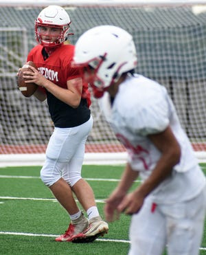 Freedom High School's Cole Beck looks to pass during practice on Sept. 1.