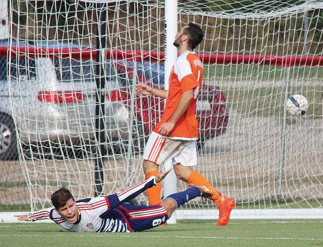Oklahoma Wesleyan University's Stefan Cvetanovic, left, displays some showmanship after scoring a goal during an earlier season in his career.