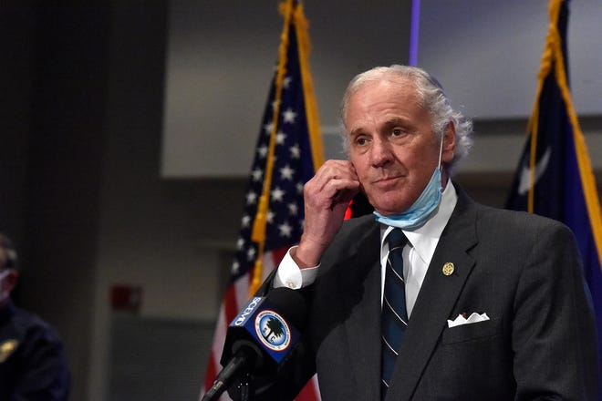 South Carolina Gov. Henry McMaster removes his mask while speaking during a COVID-19 briefing July 29 in West Columbia.