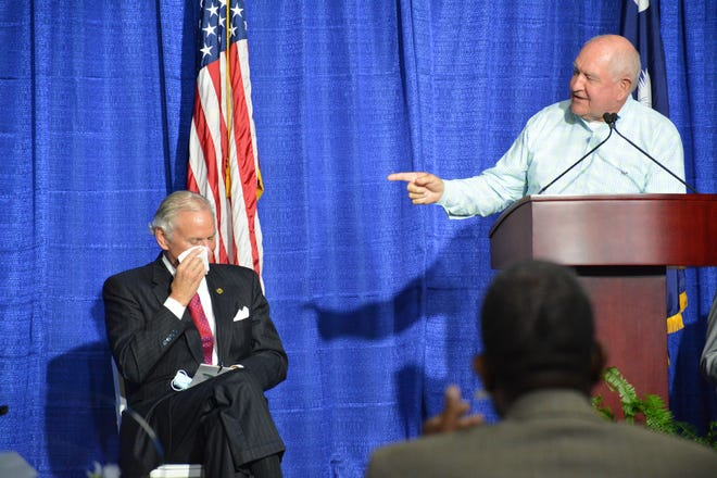 Former Georgia governor and current U.S. Secretary of Agriculture Sonny Perdue, right, shares a laugh with S.C. Gov. Henry McMaster during Wednesday's economic development announcement in Hampton County.