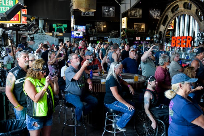 People watch a concert at the Full Throttle Saloon during the 80th Annual Sturgis Motorcycle Rally in Sturgis, South Dakota on Aug. 9.