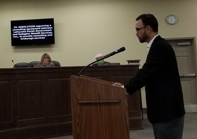 Insurance consultant Justin Bourgeois speaks at the special meeting of the Lafourche Parish Council Tuesday.