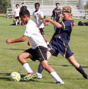 Gavin Anderson tries to stop a Pelican Rapids attacker in Crookston's 5-0 loss on Sept. 1. The Vikings beat the Pirates 10-0 in Pelican Rapids in the rematch Tuesday.