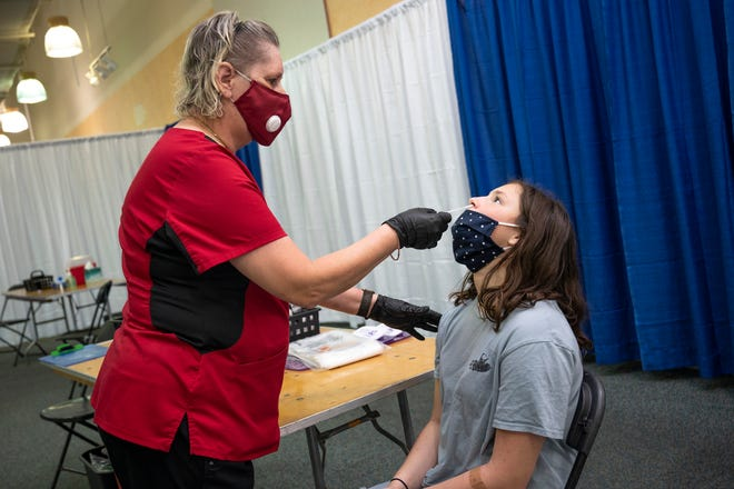 A student is tested for COVID-19 recently at the Lake Square Mall in Leesburg. [Cindy Peterson/Correspondent]