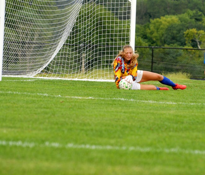 Cambridge goal keeper Jenna Young makes a diving save  on a Dover goal attempt during Tuesday's match at Cambridge High School