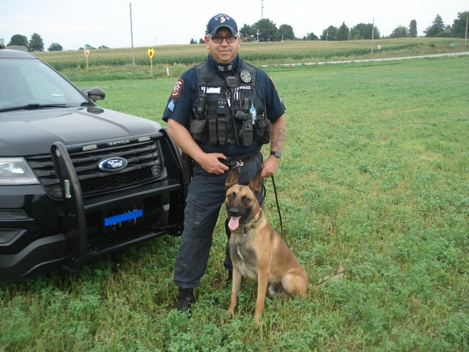 Sgt. J. David Miller, of the Rittman Police Department, and his K-9 found a pistol in a field that was discarded by a suspect during a foot pursuit.