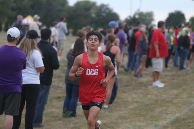 DCG's Jacob Ewers runs in a home meet earlier this season. The junior picked up a season-best time in the Little Hawkeye Conference meet on Oct. 12 in Norwalk.