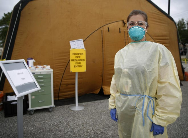 Emergency room nurse Rachael Driscoll prepares to go into the testing tent at Halifax Health Medical Center in Daytona Beach where she will work every day for the foreseeable future.