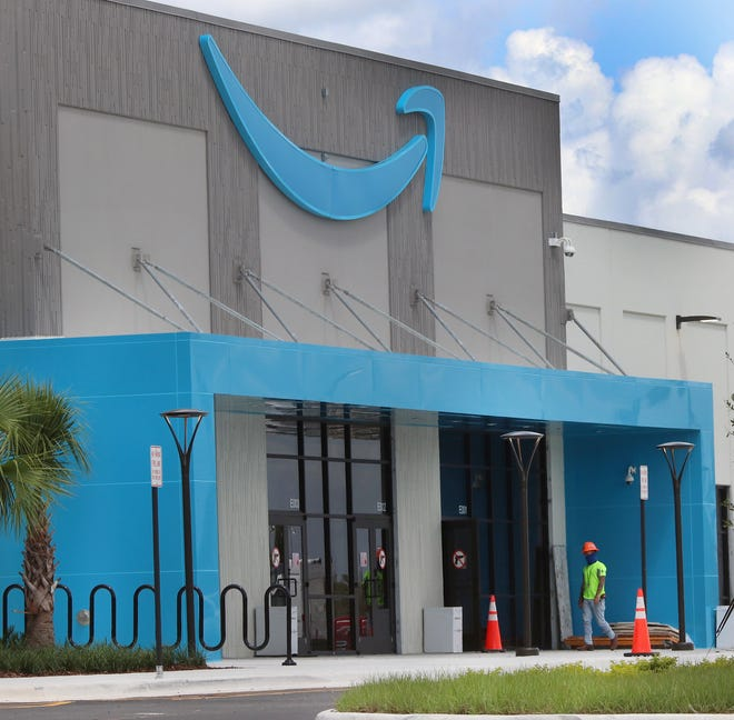 A construction worker can be seen in front of the entrance to the new Amazon distribution center in Deltona on Wednesday, Sept. 2, 2020.