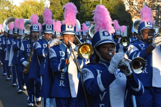 Dover High School's marching band plays during the 2019 homecoming parade.