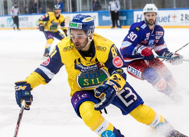 Phil Marinaccio, front, who spent the last three seasons playing in Denmark and Norway, has signed with the Kansas City Mavericks.