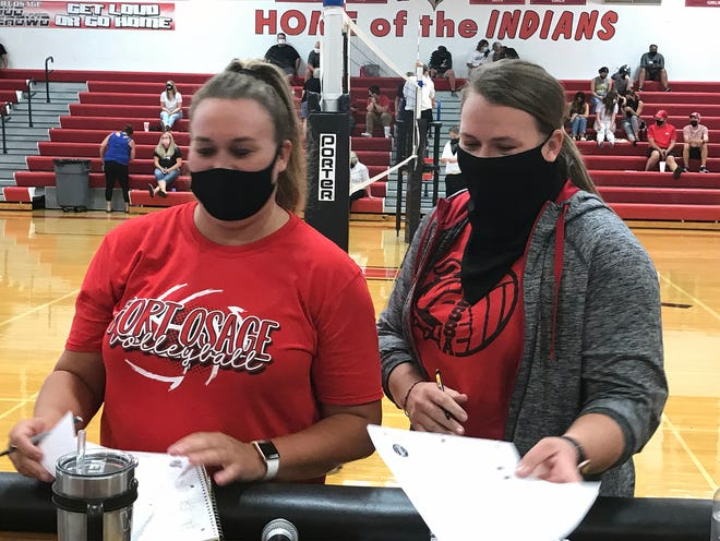 It was a family affair at Fort Osage Monday night when Melanie DeMore, right, brought her Odessa volleyball team to play sister Vanessa Gage's Indians. DeMore earned bragging rights over her big sister as the Bulldogs won 3-1.