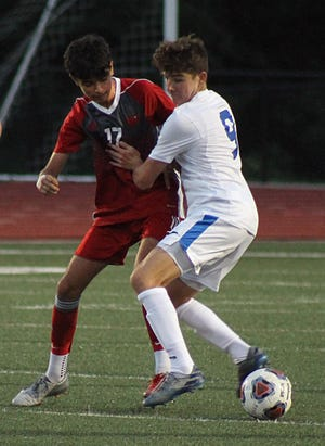 Van Horn's Jorge Venegas, left, and Blue Springs South's Dylan Prater battle for possession in a Raytown South Tournament semifinal Tuesday. Van Horn advanced to the finals with a 4-2 win.