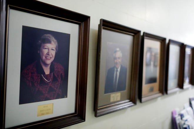 A photograph of Nancy Neafie, the first and only woman to serve as Burlington's mayor, hangs on a wall alongside other mayors past in City Hall. Neafie served in that capacity from 1990 until her death in 1993.