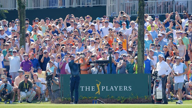 Tiger Woods hits his tee shot at the 17th hole of the Players Stadium Course at TPC Sawgrass in the 2018 Players Championship. The 2021 Players will be March 11-14.