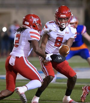 Bradford quarterback Pedro Carter (8) hands off to running back Erric Smith (2) during the 2019 Class 4A football playoffs.