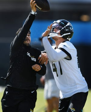 Jaguars middle linebacker Joe Schobert reaches for the ball during a drill during training camp. Schobert signed with the Jags as a free agent after four seasons in Cleveland.