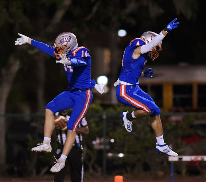 Bolles wide receivers Gunner Boree (left) and Davis Ellis celebrate a touchdown in the state semifinal against Bradford.