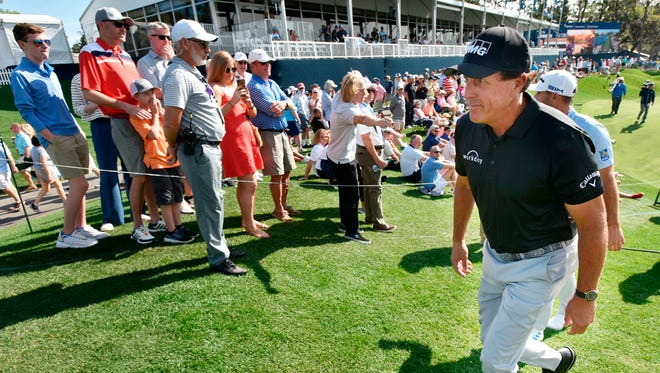 Phil Mickelson walks from the 18th green of the TPC Sawgrass Players Stadium Course during the first round of the 2020 Players Championship, which was canceled the next day. A limited number of fans will be allowed to attend this year.