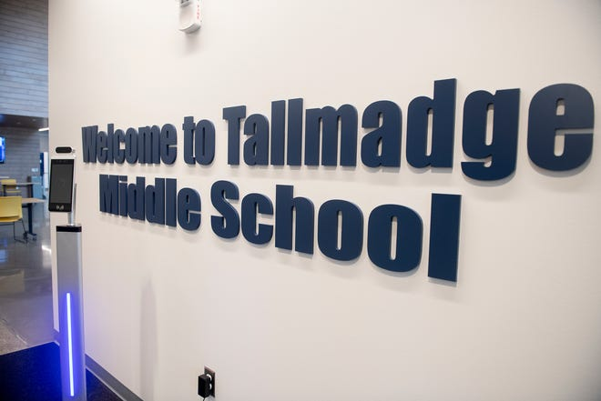 A temperature reader is at the entrance of Tallmadge Middle School, a sign of the different routines in the new school year.
