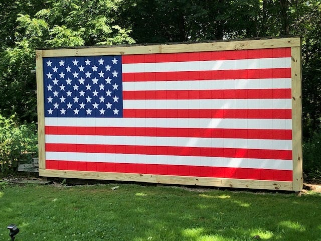 Tallmadge resident Glenn Doan transformed this shed wall into a colorful patriotic display