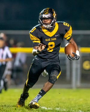 Cuyahoga Falls running back Isaiah Campbell looks for running room during a game against Hudson last season.