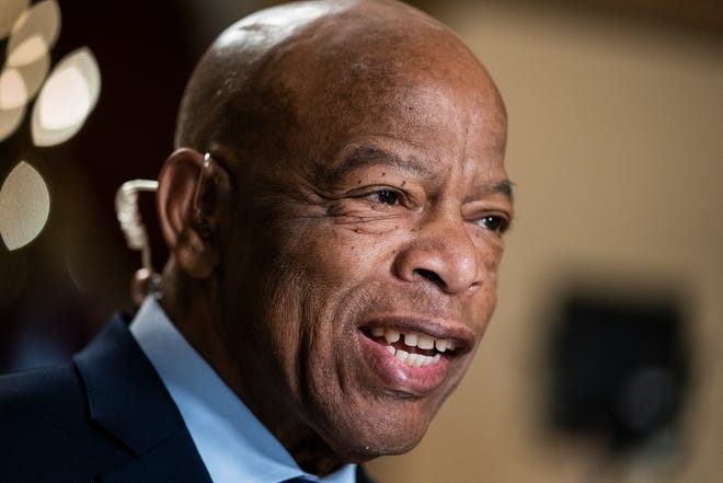 In this July 16, 2019, file photo, Rep. John Lewis, D-Ga., speaks during a television interview at the Capitol in Washington. Stow City Council will be introducing legislation Sept. 10 to rename the Route 8 bridge on Steels Corners Road in his honor.