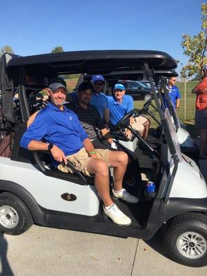 Scott Kovach, Dave Richards, Dave Kimball and Doug Barnes get ready to hit the course during last year's golf outing, sponsored by the Twinsburg Chamber of Commerce