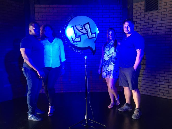 Laugh Out Lounge co-owners Jordan Mills, left, Denice Reyes, Ashta Compton and Chris Barton stand under the stage lights in their new Winter Haven comedy club, scheduled to open Oct. 2.
