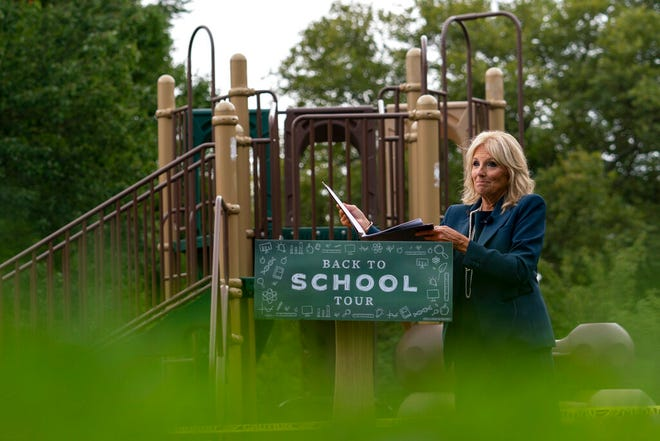 Jill Biden, wife of Democratic presidential candidate former Vice President Joe Biden, walks from a podium in front of a closed playground during a tour of the Evan G. Shortlidge Academy in Wilmington, Del., Tuesday, to launch a multi-week swing through 10 battleground states.
