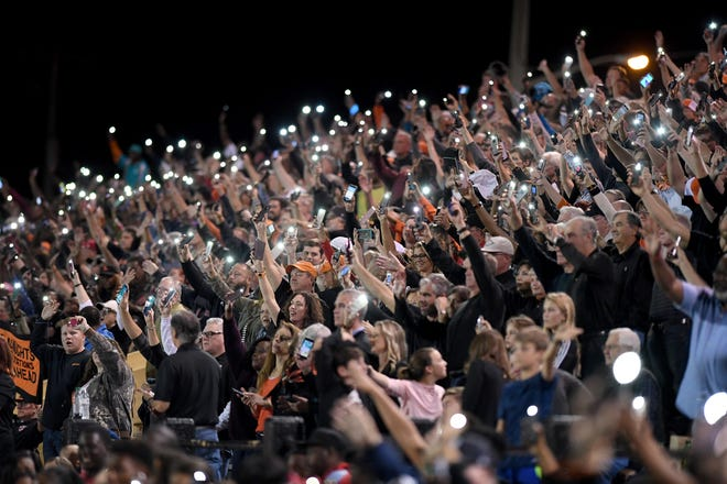 Lakeland fans do the Dreadnaught wave to children and staff on the sixth floor of the pediatric unit at Lakeland Regional Health during a game in 2018. With social distancing requirements at games, packed stands like this won't be seen for a while until the COVID-19 pandemic subsides.